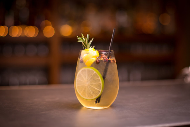 Delicious craft cocktail sitting on a bar - Shutterstock