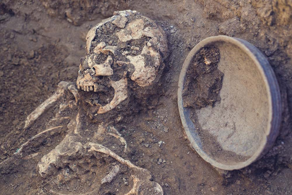 Digging up human remains can run against the cultural and religious beliefs of certain groups. (Credit: Masarik/shutterstock)