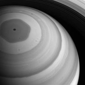 Saturn's hexagon feature towers hundreds of kilometers