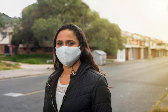 covid-19 coronavirus mask woman city outside - shutterstock