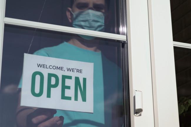 mask pandemic small business open - shutterstock