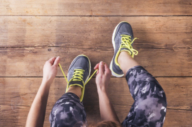 Putting on Shoes, Exercise, Running, Workout - Shutterstock