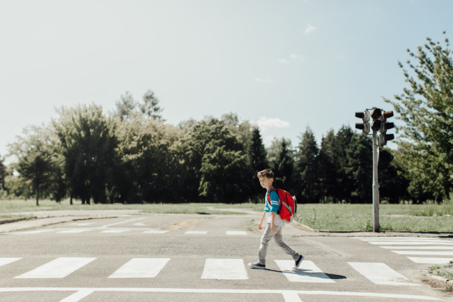 Child crossing the street - shutterstock