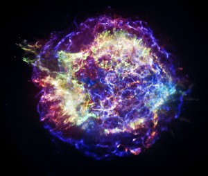 A bright glowing cloud of gas in space.