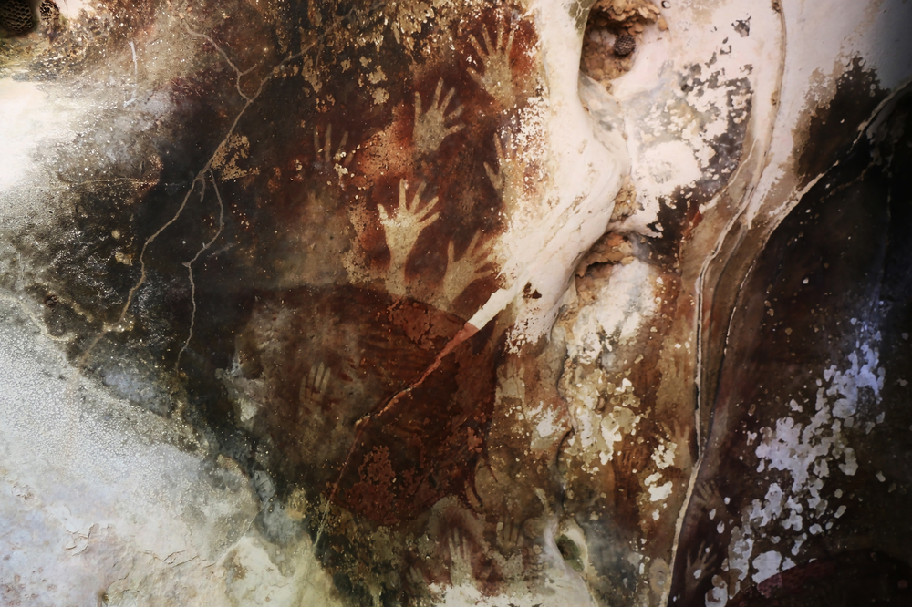 What the Oldest Known Cave Painting Reveals About Early Humans (and What It Doesn't)