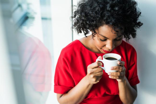 Woman Drinking Coffee - Shutterstock