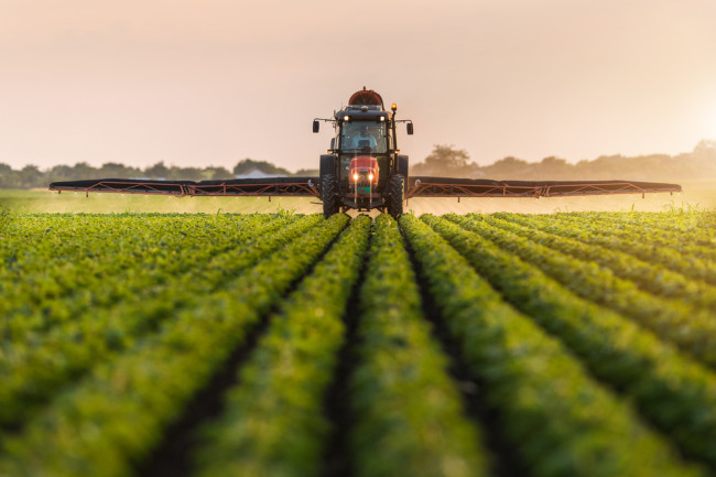 Tractor Spraying Crops - Shutterstock