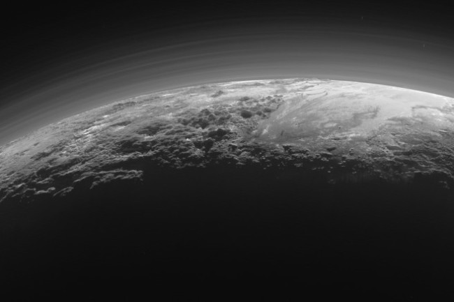 "Pluto is a beautiful world, with ice mountains, nitrogen glaciers, a haze-layered atmosphere, and methane dunes. But all that complexity does not necessarily make it a ""planet."" (Credit: NASA/JHUAPL/SwRI)"