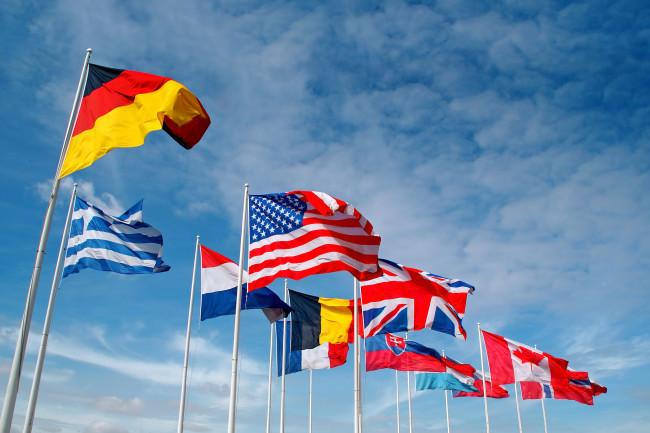 World flags flagpoles - Shutterstock