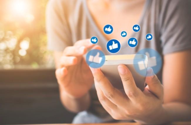 Facebook Likes Social Media Tech Addiction - Shutterstock