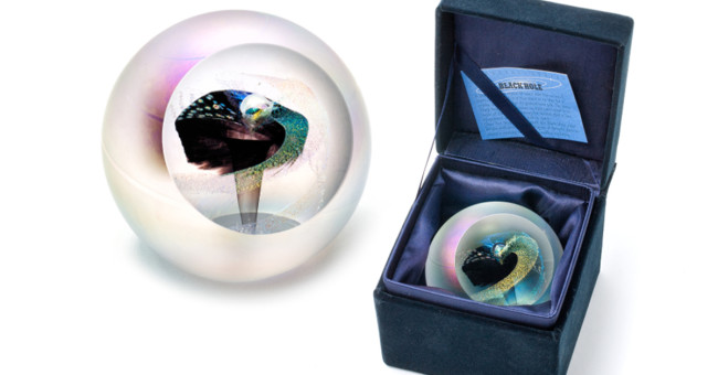 a picture of the black hole paperweight in a velvet box