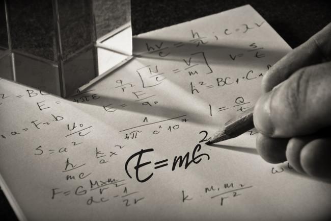 einstein's equation written on a piece of paper - shutterstock 476432692