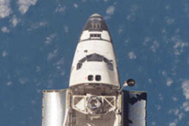 Discovery space shuttle backflip