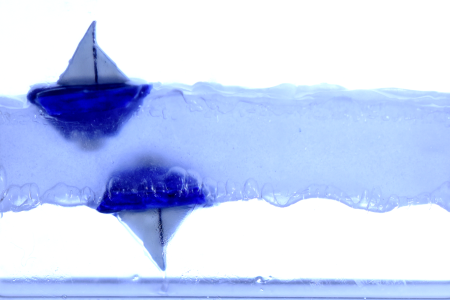 These Tiny Boats Can Float Upside Down on Levitating Liquid
