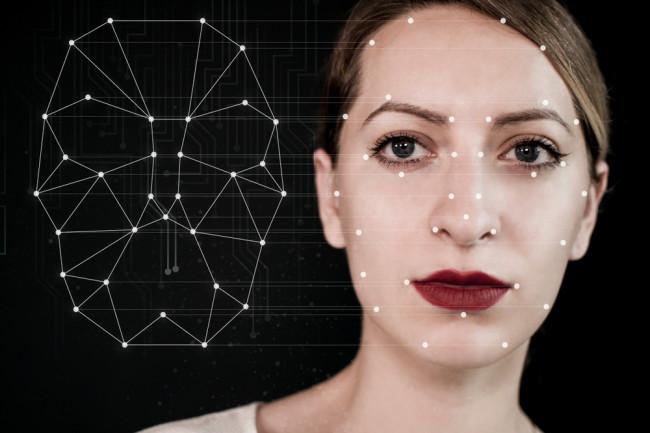 AI tech woman face technology deepfake - shutterstock