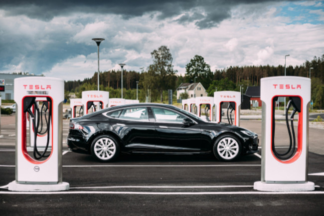 Tesla Car Charging - Shutterstock