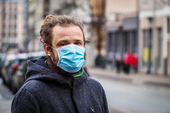 Man in Face Mask Pandemic - Shutterstock