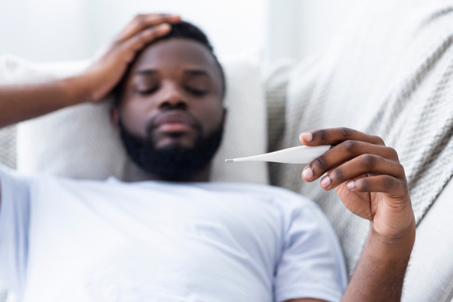 flu or covid-19 fever - shutterstock