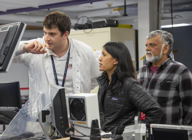 MiMi Aung (center) with NASA engineers Teddy Tzanetos (left) and Bob Balaram, who developed the concept of a Mars helicopter in the 1990s. (Credit: NASA/JPL-Caltech)
