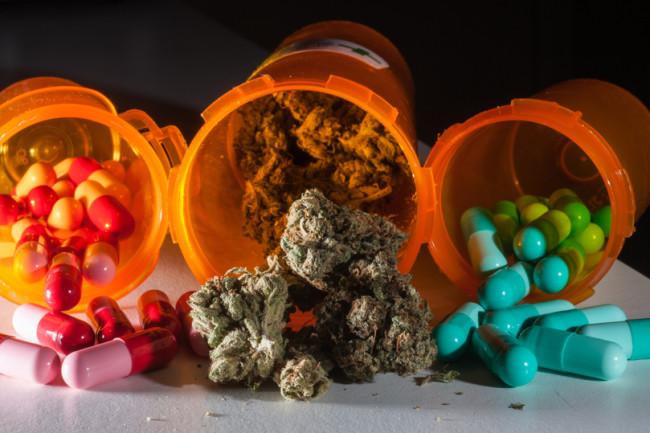 Pills and Marijuana in Prescription Drug Bottles - Shutterstock