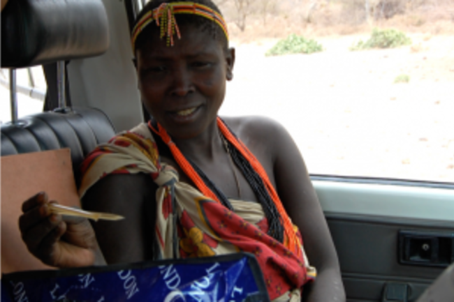 Hadza-woman-with-honey-stick-300x287.png