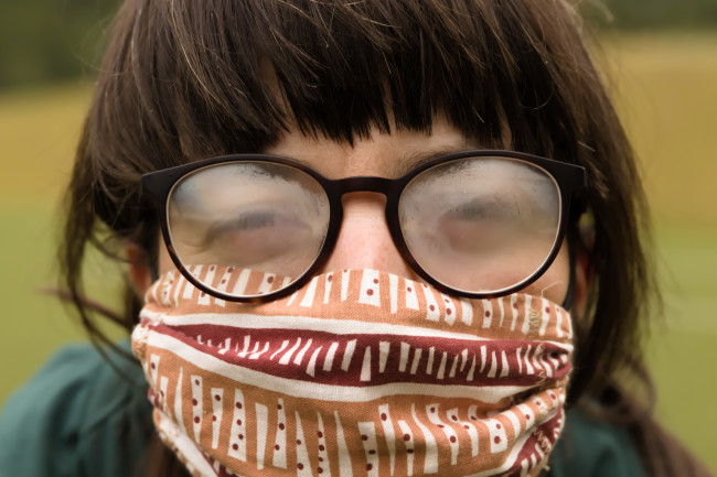 Person wearing a mask and fogged glasses - Shutterstock