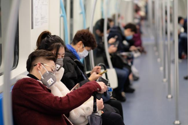 coronavirus - subway - masks - shanghai - shutterstock