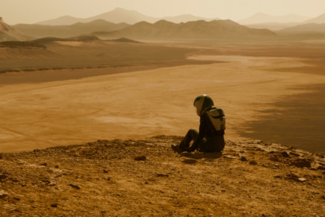 Life on Mars: One of the scientists spies on a new commercial drilling site in Season 2. (Credit: National Geographic/Richard Donnelly)