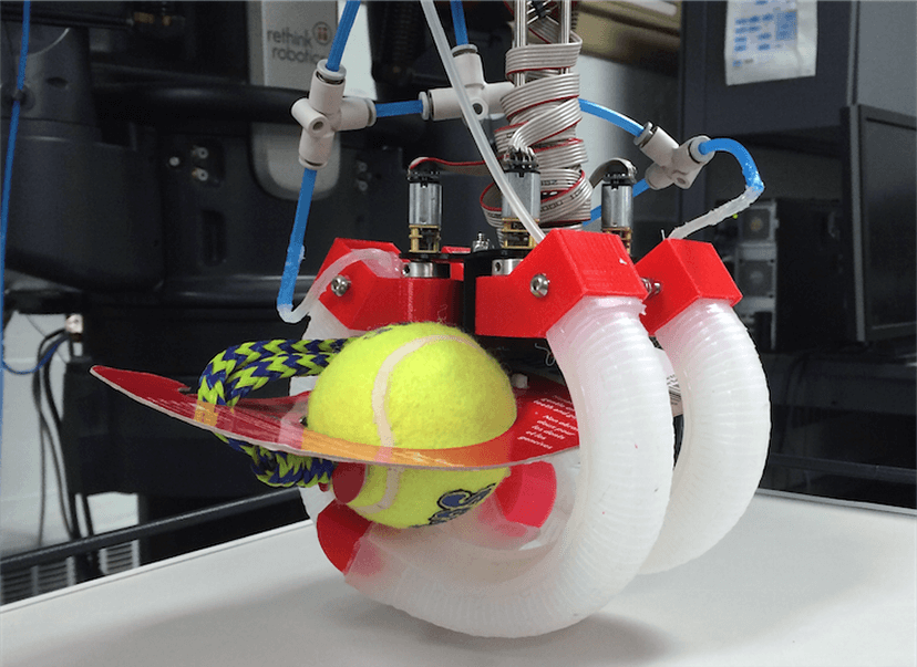 Instead of hands that closely mimic our own, some researchers are working on soft, flexible ones made of silicone. In this image, hollow silicone fingers curl as they're filled with air, squeezing them around unusually shaped objects. (Credit: J. MORROW ET AL / IEEE INTERNATIONAL CONFERENCE ON ROBOTICS AND AUTOMATION (ICRA) 2016)