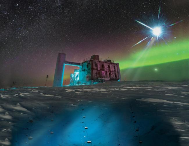 This image combines a real photograph of the IceCube Lab in Antarctica with an artist's rendering of the project's sensors deep below the ice and the distant blazar from which a neutrino has been detected. (Credit: IceCube/NSF)