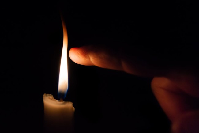 Candle Flame Finger - Shutterstock