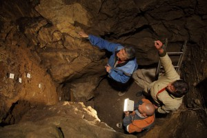 Archaeologists working in the in the East Chamber of Denisova Cave, Russia. (Credit: IAET SB RAS, Sergei Zelensky)