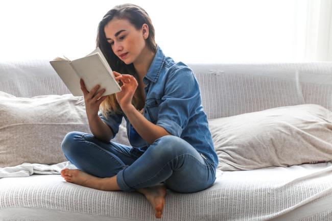 woman reading book - shutterstock