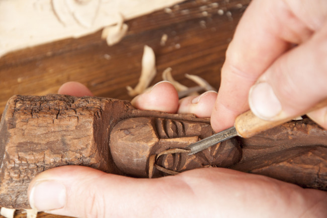 Wood working hand carving - shutterstock