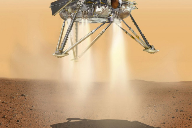 a lander hovering above the surface of Mars