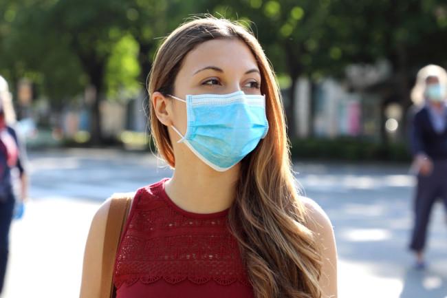 Coronavirus woman mask outdoors - shutterstock