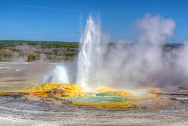 Geyser in Yellowstone - Shutterstock