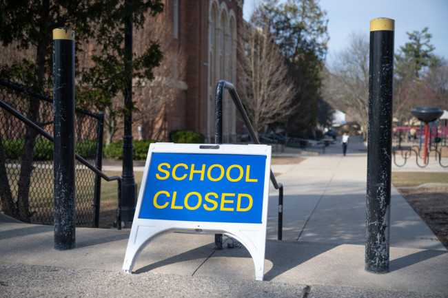 School closed sign playground covid lockdown - shutterstock