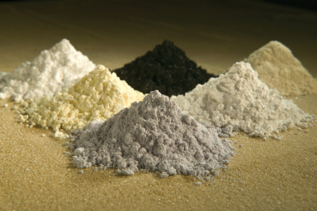 These rare-earth oxides are used as tracers to determine which parts of a watershed are eroding. Clockwise from top center: praseodymium, cerium, lanthanum, neodymium, samarium, and gadolinium. (Credit: Peggy Greb, US Department of Agriculture)