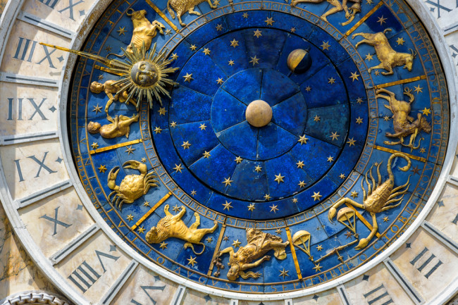 Ancient clock face italy roman numerals and zodiac - shutterstock