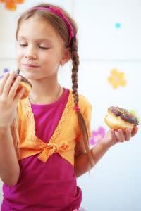 girl-eating-donuts-200x300.jpg