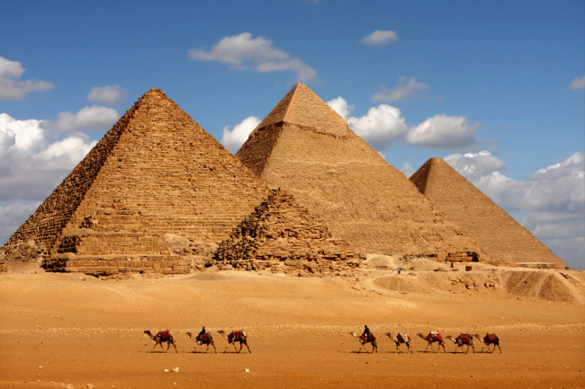pyramids in eqypt with camels - shutterstock