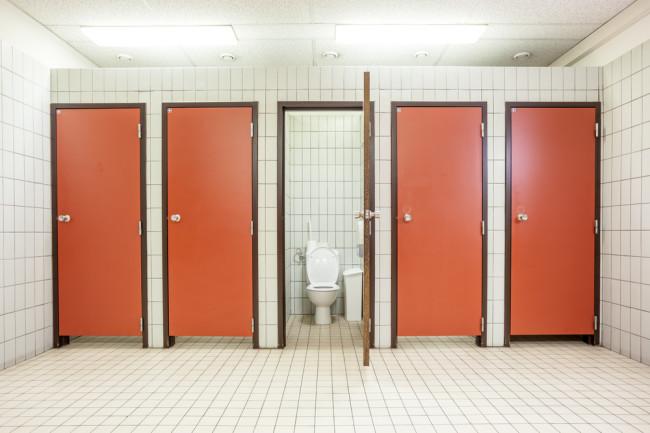 public restroom red doors - shutterstock
