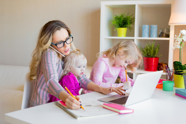 mom working from home and balancing childcare - shutterstock 1070125520