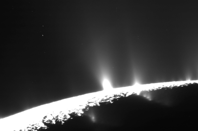 Cassini image of plumes bursting from the surface of Enceladus. (Credit: NASA:JPL-Caltech:Space Science Institute)
