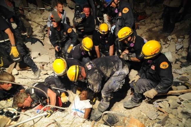 Team pulls a woman from Haiti earthquake rubble