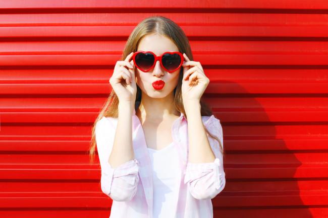 woman wearing red lipstick and heart sunglasses - shutterstock 407717485