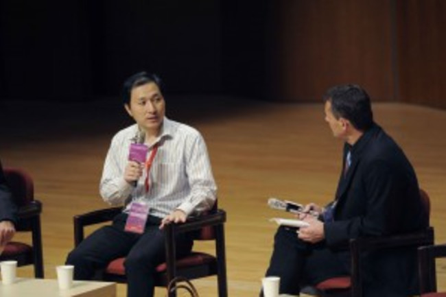 Chinese scientist He Jiankui talks with Matthew Porteus of Stanford University during a panel discussion after He presented his research in Hong Kong last November. (Credit: Ernie )