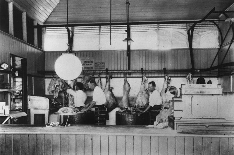 800px-StateLibQld 1 14914 Butchers at work inside Loch Bros Emerald ca 1928