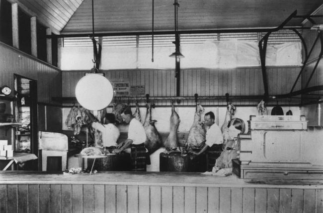 800px-StateLibQld 1 14914 Butchers at work inside Loch Bros Emerald ca 1928